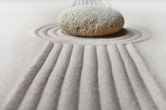 Zen garden raked sand and stone pattern Stock Images