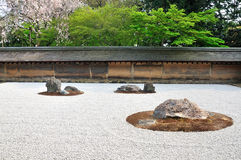 Zen garden, raked the stones of the Ryoanji Temple garden. In Japan Royalty Free Stock Photo