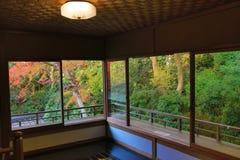 Zen garden at Rurikoin, all viewed through a window. A zen garden at fall season at japan at Rurikoin Royalty Free Stock Images