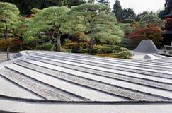 Zen garden with sand tower Stock Images
