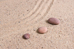 Zen garden sand waves and rock sculptures Stock Photos