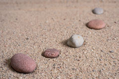 Zen garden sand waves and rock sculptures Royalty Free Stock Photos
