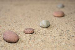 Zen garden sand waves and rock sculptures Royalty Free Stock Image