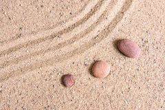 Zen garden sand waves and rock sculptures Stock Images