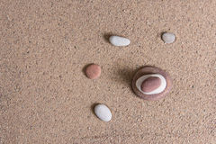 Zen garden sand waves and rock sculptures Stock Photo