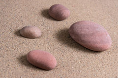 Zen garden sand waves and rock sculptures Royalty Free Stock Images