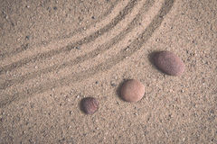 Zen garden sand waves and rock sculptures. Vintage. Royalty Free Stock Photo