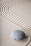 Zen garden spirituality purity spa background. Zen garden japanese garden zen stone with raked sand and round stone tranquility and balance ripples sand pattern Royalty Free Stock Photos
