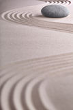 Zen garden stone spa background. Zen garden japanese garden zen stone with raked sand and round stone tranquility and balance ripples sand pattern spa background Royalty Free Stock Photos