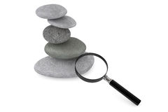 Zen garden stones and magnifying glass Royalty Free Stock Images