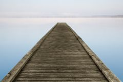 Zen jetty on foggy lake Stock Photo