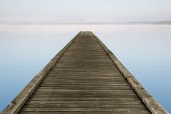 Zen jetty on foggy lake Stock Photo