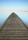 Zen jetty on misty lake Royalty Free Stock Photos