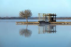 Zen lake in the fog. Rustic jetty on a zen-like idyllic lake in Aquitaine, France royalty free stock photos
