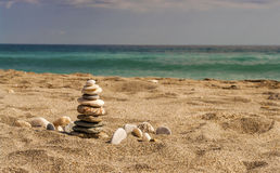 Zen like high balanced stones pile on the sea beach Royalty Free Stock Photography