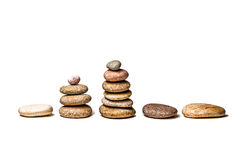 Zen like row and stacks of pebbles Royalty Free Stock Photography