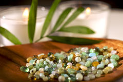 Zen-like scene. Zen-like stones, candles, and bamboo Royalty Free Stock Photography