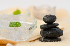 Zen-like SPA. Zen-like stones with water drops and green leafs Stock Photo