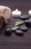Zen-like spa. Detail with black stones Royalty Free Stock Images