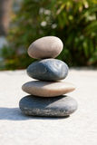 Zen like stones. Stack on green background Stock Image