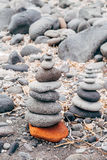 Zen like stones on beach. In Santorini stock image
