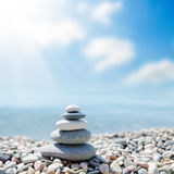 Zen-like stones on beach under sun. Soft focus Royalty Free Stock Image