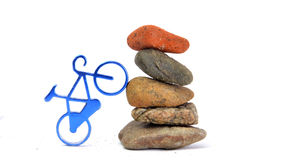Zen like stones and blue  bike Royalty Free Stock Images