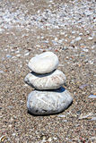 Zen like stones stack on the beach. Zen stones stacked at beach against a sand and gravel background Royalty Free Stock Photos