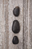 Zen Massage Stones on Rustic Wood Royalty Free Stock Photos