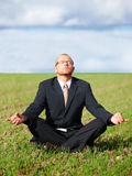 Zen meditation - Businessman doing zen Royalty Free Stock Image