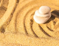 Zen meditation stone in sand, concept for purity harmony and spi Royalty Free Stock Images