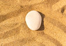 Zen meditation stone in sand, concept for purity harmony and spi Stock Photo