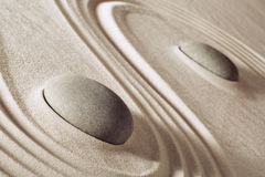 Zen meditation stones. Lines in sand for balance harmony and relaxation spa massage stone, spirituality and purity japanese rock garden background Stock Image