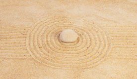 Zen mindset concept. On yellow sand with stone Royalty Free Stock Image