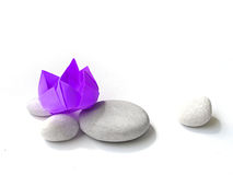 Zen mood. A high key still life photograph of an origami or paper craft folded flower, purple lotus bloom. Taken on clean white background with copy space stock images