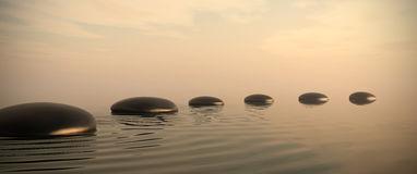Zen path of stones on sunrise in widescreen Stock Photo