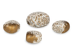 Zen patterned stones. Handicraft,  isolated on a white background Royalty Free Stock Images