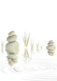 Zen Peace. Zen abstract of  grey spa stones with bamboo grass and reflection  in rippled  water, over white background Royalty Free Stock Photography