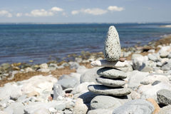 Zen pebble statue. Zen like pebble statue on a beach in Wales royalty free stock images