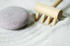 Zen Pebble to left with rake Stock Photos