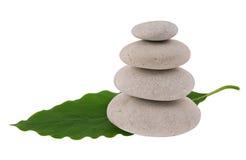 Zen pebbles on a leaf Stock Photos