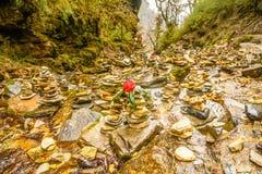 Zen rock arrangement along hiking trail mountains of Nepal Stock Image