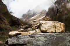 Zen rock arrangement that mimic the Stupa along hiking trail to the mountains of Annapurna, Nepal.  Stock Photo