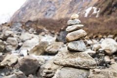 Zen rock arrangement that mimic the Stupa along hiking trail to the mountains of Annapurna, Nepal Stock Photography