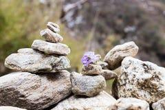 Zen rock arrangement that mimic the Stupa along hiking trail to the mountains of Annapurna, Nepal.  Stock Photos