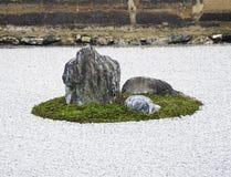 Zen Rock Garden in Ryoanji Temple, Kyoto, Japan. Zen Rock Garden in Ryoanji Temple.In a garden fifteen stones on white gravel. Kyoto.Japan Stock Photos