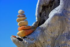 Zen rock tower on log Royalty Free Stock Photos