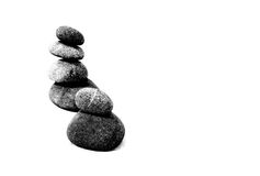 Zen rocks. Zen theme with rocks balanced on top of each other against a white background Stock Images