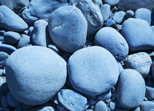 Zen Rocks. Blue toned zen rocks smoothed by the ocean Royalty Free Stock Images