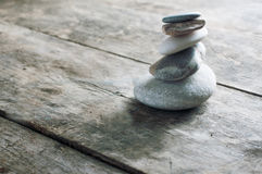 Zen rocks on old wooden plank Royalty Free Stock Photo
